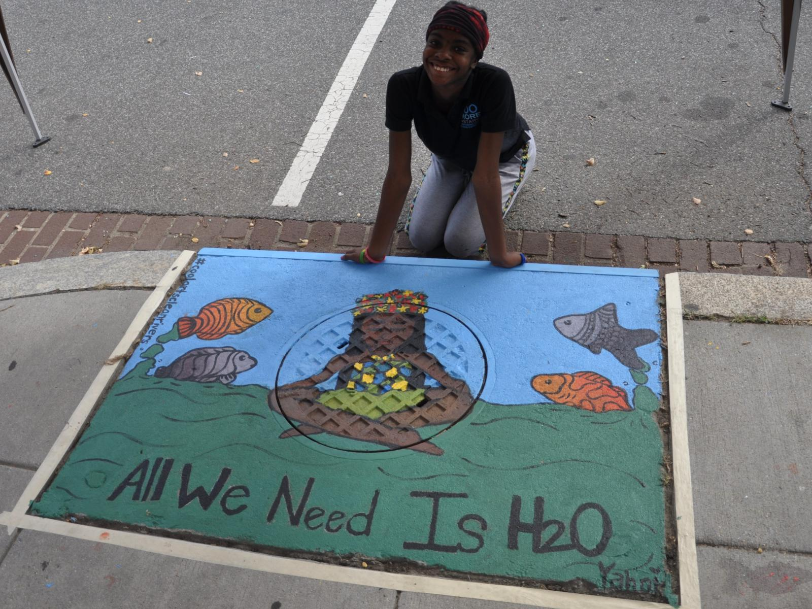 Artist and storm drain painting